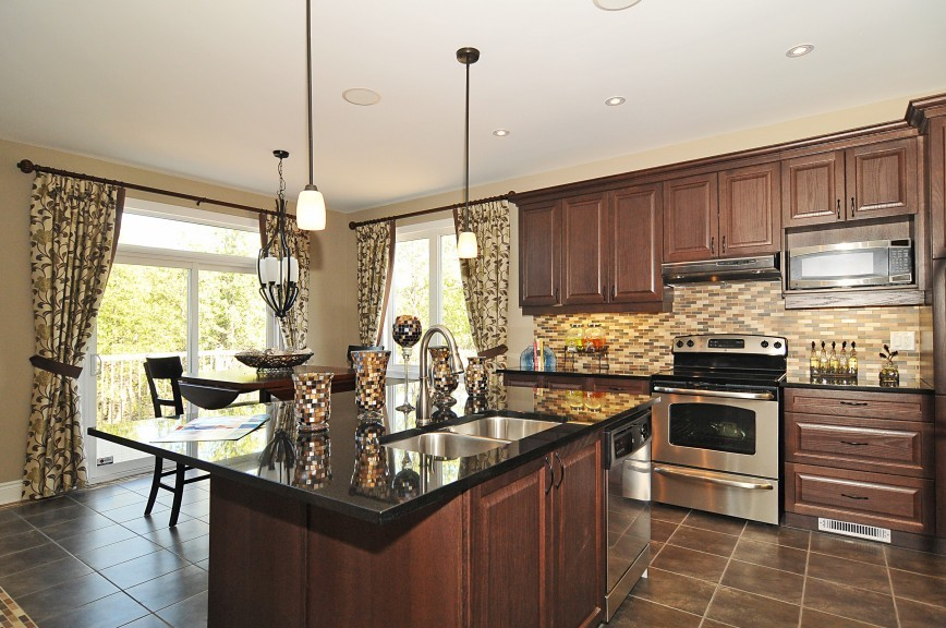 Cartestian Home Kitchen with a Flush Breakfast Bar