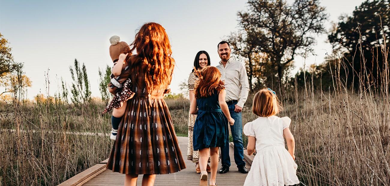 family on wooden boardwalk