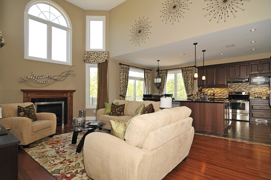Cartesian living room attached with open kitchen byPhoenix Homes