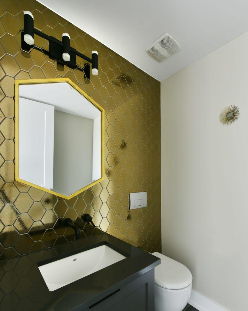 gold paneled bathroom