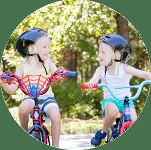 two girls on bikes circle png image