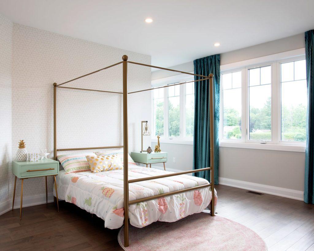 large bedframe woman's bedroom