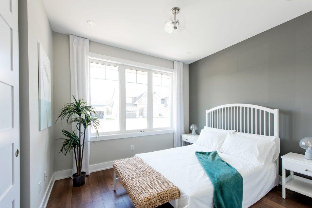 white bed frame blinds open