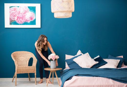 woman decorating her bedroom